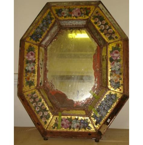 An impressive Italian micromosaic framed wall mirror, 19th Century the octagonal bevelled plate within a raised border of eight colourful micromosaic floral panel on a gilt tile ground, and etched mirror panels, spiral and twisted canes, losses,103 x 82cm.