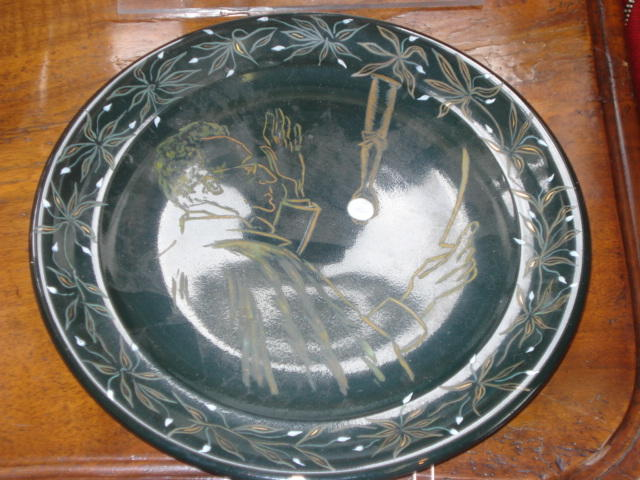 A painted black glazed ceramic plate