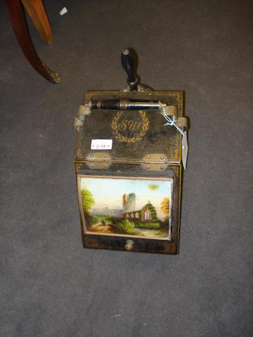A late 19th/early 20th century black tôle and gilt decorated coal scuttle