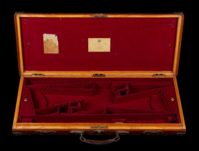 A James Purdey & Sons brass-mounted oak and leather double-guncase