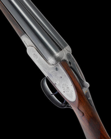 A 12-bore self-opening sidelock ejector gun by J. Purdey & Sons, no. 23850 In its brass-mounted oak and leather case
