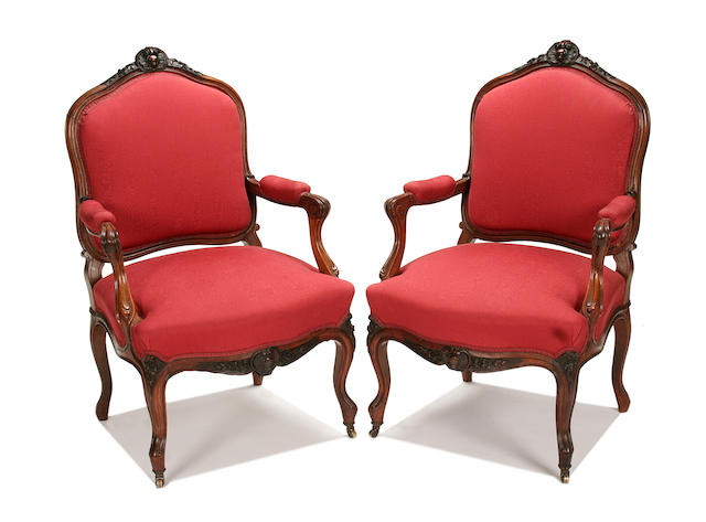 A pair of late 19th century carved rosewood fauteuils
