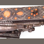 An important Ottoman coral-set flintlock Rifle, signed Mehmet North Africa, dated AH 1126/ AD 1714-15