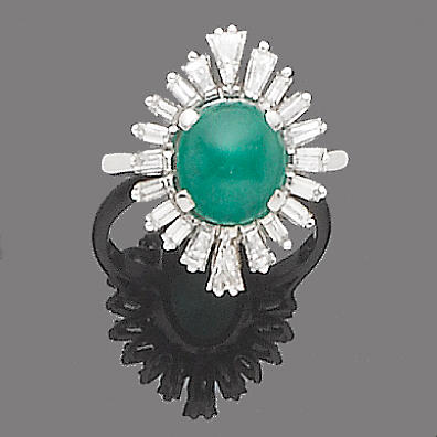 An emerald and diamond cluster ring, by Garrard