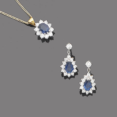 A sapphire and diamond pendant necklace and a pair of sapphire and diamond earrings (2)