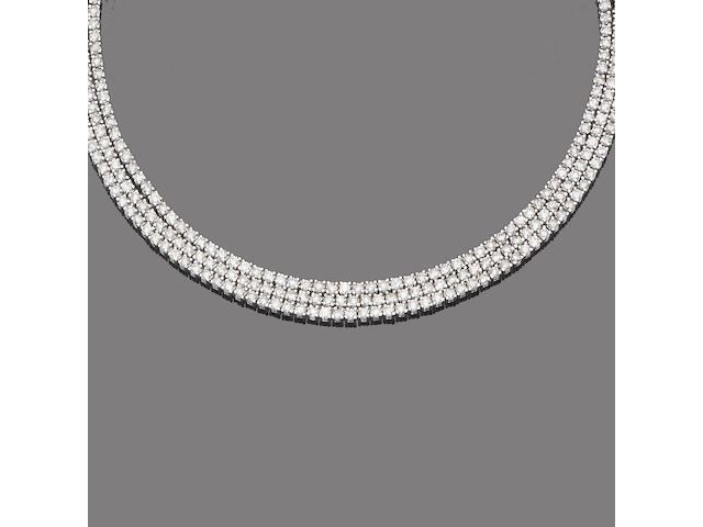 A diamond three-row necklace and bracelet suite (2)