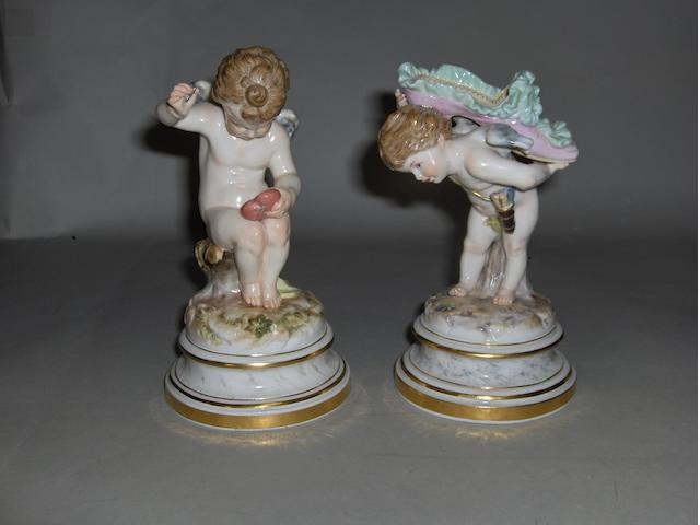 Two late Meissen figures, Cupid mending a heart,(needle a/f) and cupid carrying a slipper 17cm high (2)