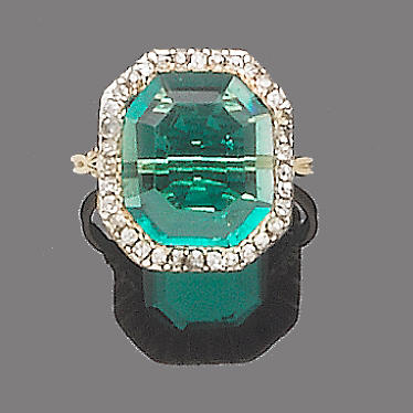 An early 19th century emerald and diamond dress ring