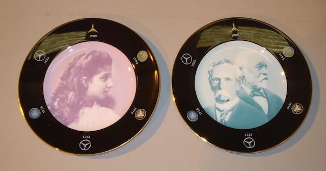 A pair of Mercedes-Benz bone china commemorative plates, by Wedgwood,