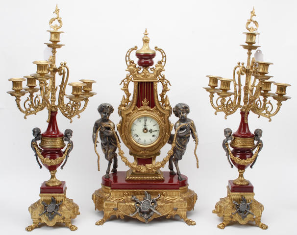A reproduction gilt metal clock garniture, 3