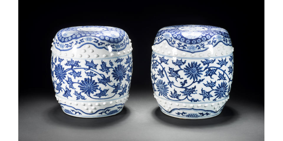 A pair of small blue and white barrel seats