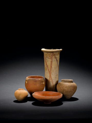 A Nubian cup, 1st Century BC; a saucer dish, late period 24th Dynasty; two Pre-Dynastic bowls and a vase (5)