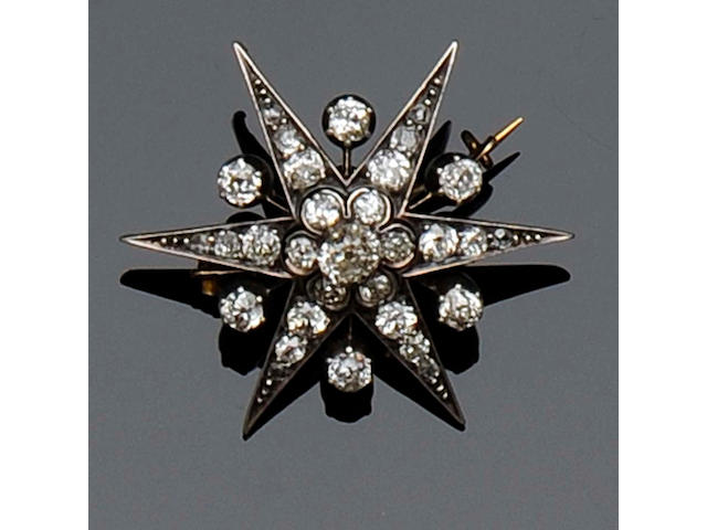 A Victorian diamond set star brooch