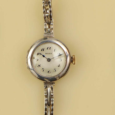 Rolex: A silver cased manual wind trench style wristwatch,