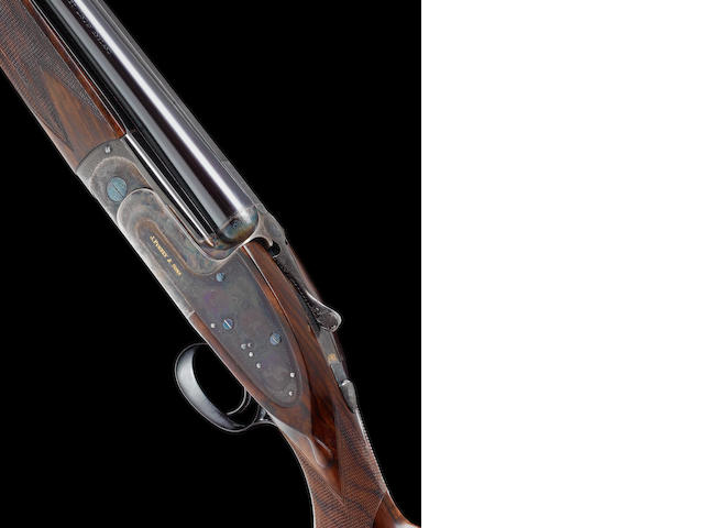 A fine Alison L. Hunt-engraved 12-bore (2¾in) single-trigger over-and-under sidelock ejector gun by J. Purdey & Sons, no. 28886 In its leather case with makers accessories, and together with its original stock