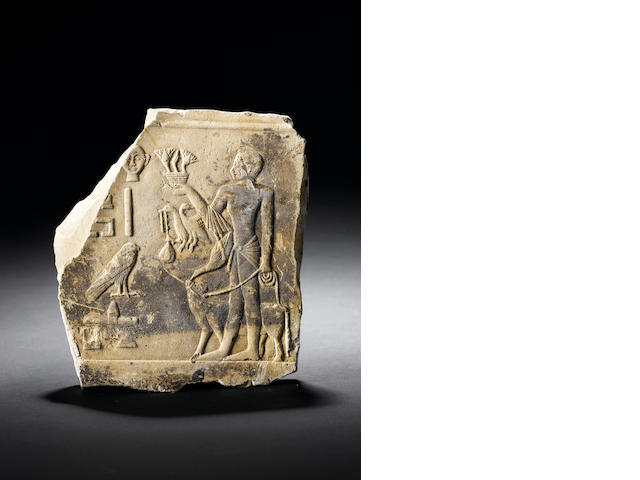 An Egyptian sandstone/limestone relief fragment