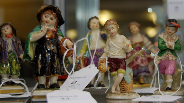 A small collection of Continental porcelain figures