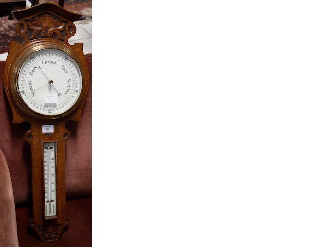 A Victorian carved oak aneroid barometer,