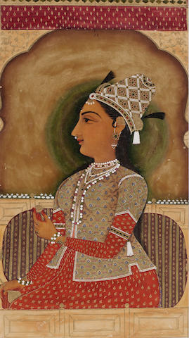 A portrait of a princess seated at a window holding a gold cup and flask Jaipur, circa 1800