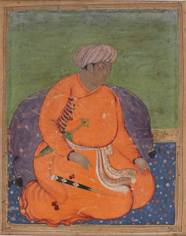 A seated prince in orange Mughal