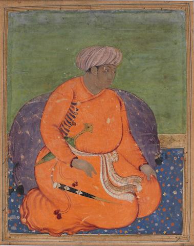 A seated prince in orange Mughal