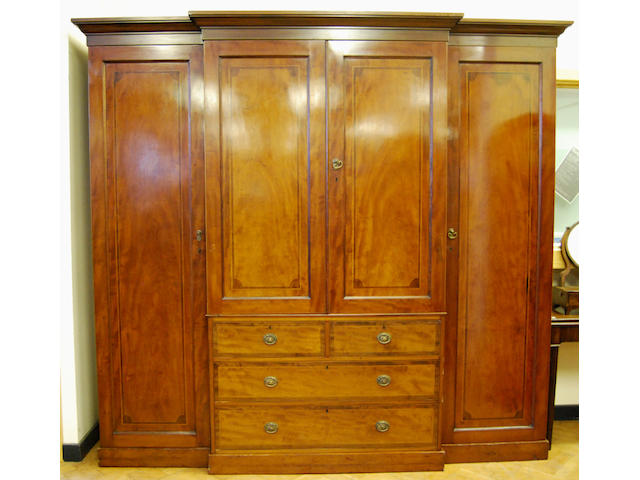 A large mahogany and inlaid breakfront wardrobe, late 19th Century