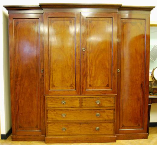 A large mahogany and inlaid breakfront wardrobe, late 19th Century