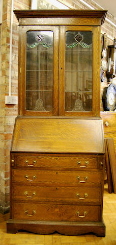 An oak and inlaid bureau bookcase, early 20th Century