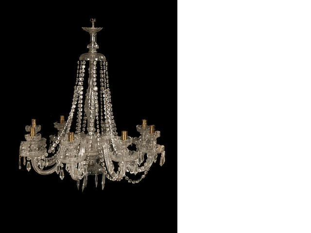A cut and moulded glass eight light chandelier