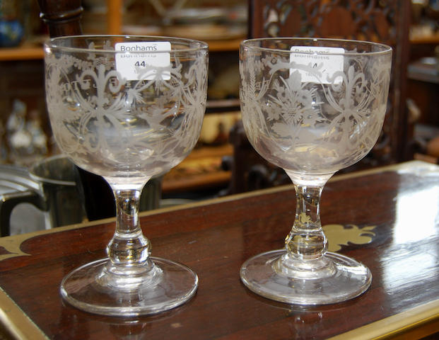 A pair of engraved early 19th century glasses