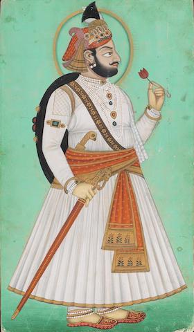 Gentleman holding a flower Udaipur