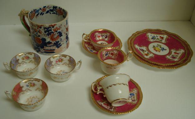 An early 19th Century English tea and coffee service, painted with panels of floral bouquets, on a pink marble effect ground heightened with gilding, a Coalport harlequin tea service painted with floral bouquets heightened with gilding, early 19th Century English Ironstone Japan pattern quart mug and other ceramics.