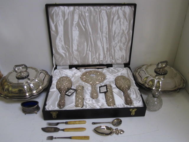 A cased silver mounted six piece dressing table set, Broadway & Co, Birmingham 1975, heavily embossed in late Victorian style, George V embossed silver mounted spherical cut glass perfume bottle, Edwardian navette shape silver salt cellar, in George III style, with slat pierced sides, sets of five each silver teaspoons and coffee spoons, silver sifter spoon, Victorian child's silver spoon and fork, nine items of George III and later silver and flatware, foreign metalware fancy spoon and fork, and a pair of electroplate entree dishes in George III style.