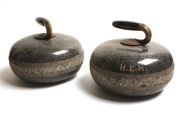 A pair of granite curling stones