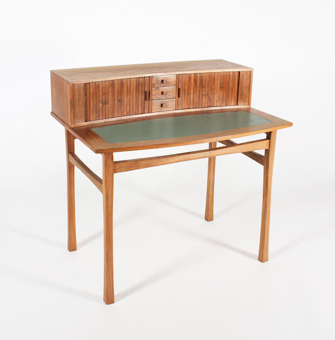 A figured walnut writing table in the style of the Barnsley Workshops