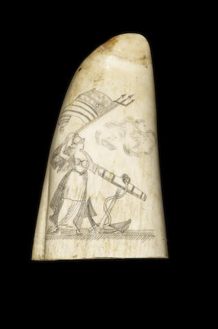 A scrimshawed whale's tooth, 6in (15cm) high.