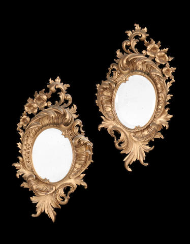A pair of gilt Rococo style mirrors