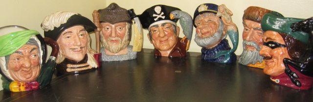Royal Doulton large character jugs:- 'Sairey Gamp', D5451; 'Old Salt', D6551; 'Long John Silver', D6335; 'Dick Turpin, D6528; 'Gladiator' D6550; 'Robinson Crusoe' D6532 and 'Aramis' D6441. (7)