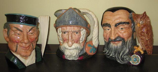 A rare Royal Doulton large character jugs:- 'The Mikado' D6501; 'Merlin' D6529, large and Don Quixote' D6455. (3)