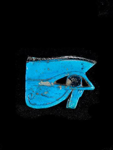 A large Egyptian blue glazed composition udjat eye amulet