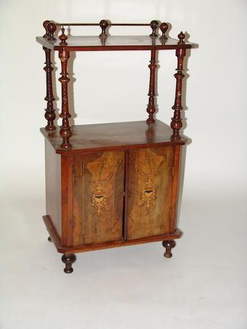 A Victorian walnut whatnot music cabinet