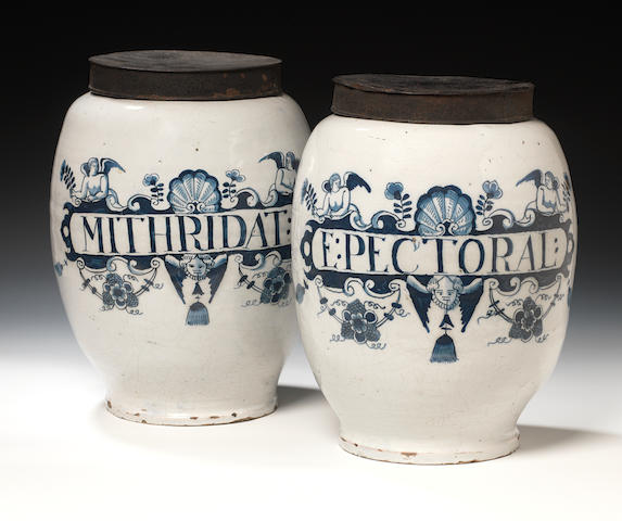 A pair of English Delft Apothacary jars (with metal covers)
