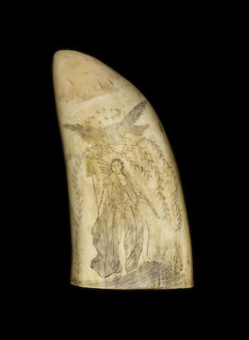 A scrimshawed whale's tooth,  19th century,  4 3/4in (12cm) high; 300 gms