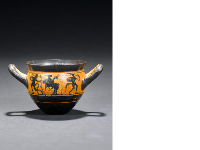 An Attic black figure handled mastoid cup