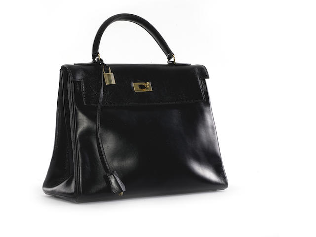 An Hermès black leather 'Kelly' bag,