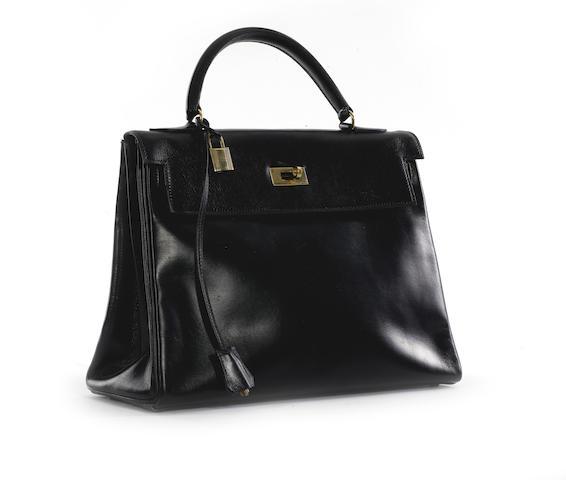 An Hermès black leather 'Kelly' bag,