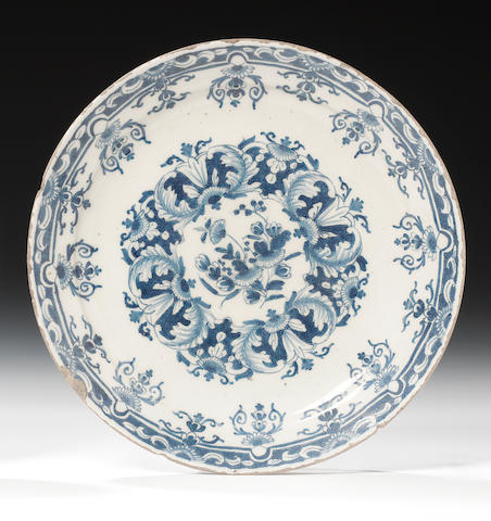 A rare English delftware plate, dated 1715