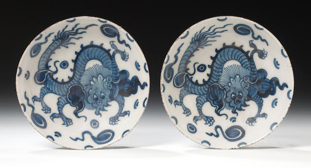 An unusual pair of English delftware dragon bowls, circa 1760