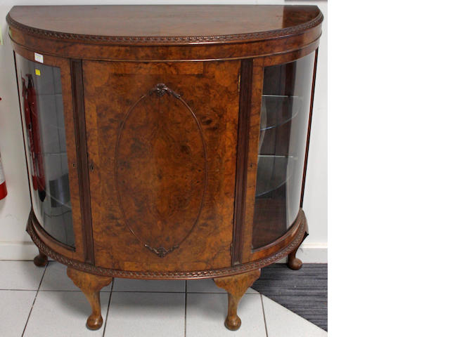 An early 20th Century burr walnut bow front display cabinet,