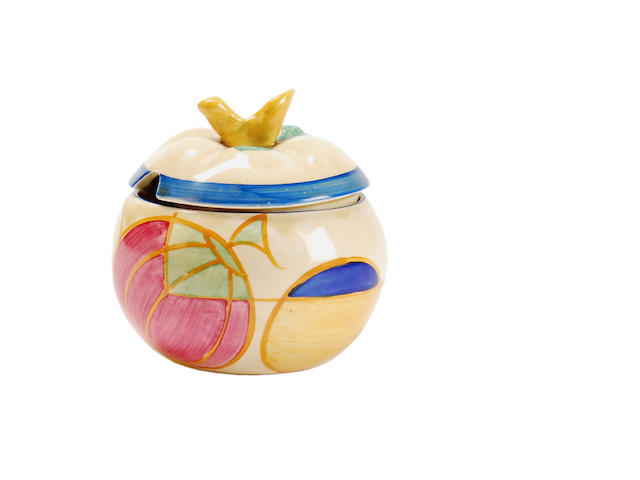 A Clarice Cliff 'Melon (Picasso Fruit)' pastel preserve pot and cover 1930